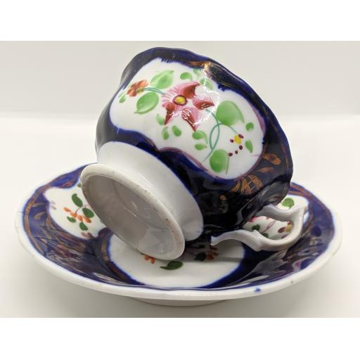 Gaudy Welsh 'columbine' teacup and saucer c 1835
