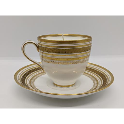 Minton gold and white coffee cup and saucer c 1918