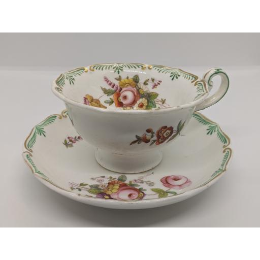 Regency loop handled footed Staffordshire teacup and saucer c 1830