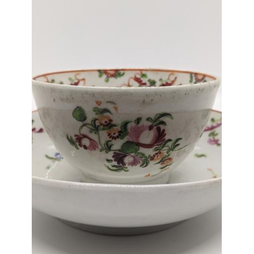 New Hall 'knitting wool' tea bowl and saucer c 1790